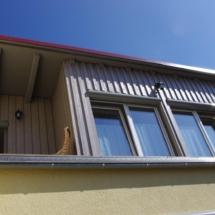 Holzrahmenbau, Einblasdämmung, Holzfassade gestrichen